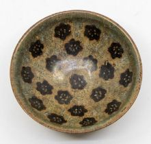 A ChineseJizhoupapercut bowl,of conical form, the interior with nineteen papercut-resist prunus