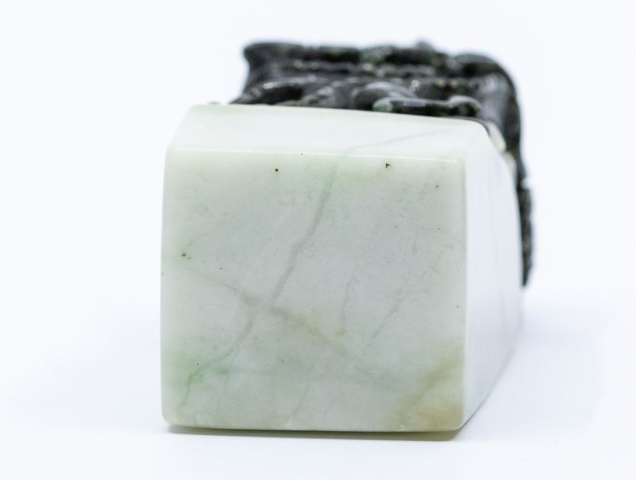 A black and white jade seal,the top carved with a dragon clutching a flaming pearl, the stone of - Image 3 of 3