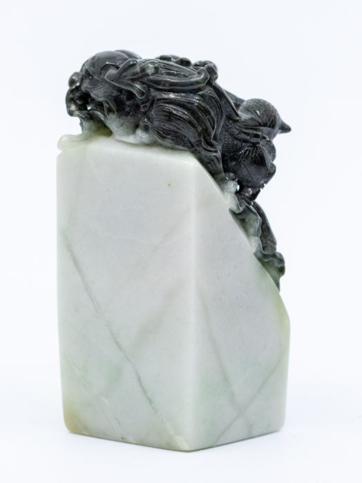 A black and white jade seal,the top carved with a dragon clutching a flaming pearl, the stone of - Image 2 of 3