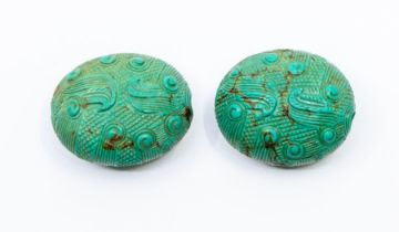 A pair of Chinese turquoise Han or Han style oval belt ties,carved with scroll work, 3.3cm long (2)