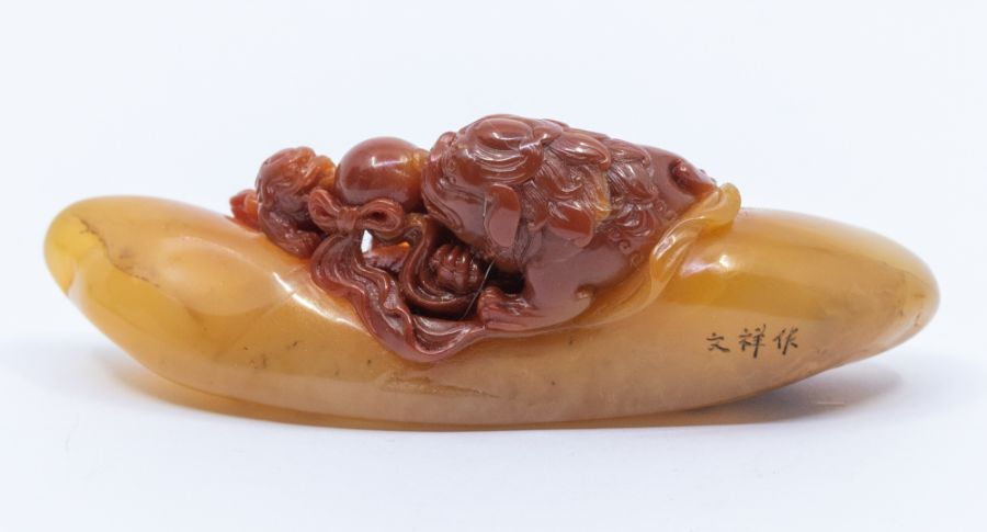 An amber and deep red soapstone carving of a Buddhist lion and cub with a ball, signed Wen Xiang - Image 3 of 4