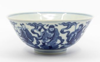 A Chinese blue and white 'immortals' bowl,the rounded sides rising from an inverted foot to a