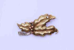 A gold leaf brooch