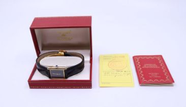 A Must de Cartier silver gilt lady's watch with black dial, lather stamp in box with papers
