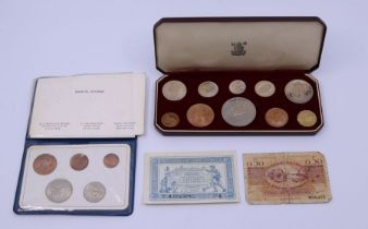 A specimen coin set and bank notes