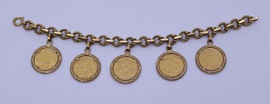A yellow gold fancy link bracelet suspending three half sovereigns dated 1896, 1925, 1910 and two