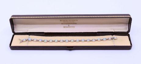 Opal and diamond white gold bracelet