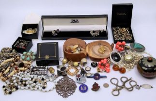 A collection of nurses and hospital related badges and a collection of costume jewellery