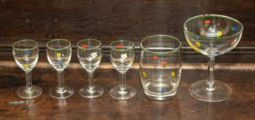 A group of eleven champagne glasses, eight liqueur glasses, two tumblers decorated with polychrome