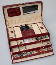 A large quantity of costume jewellery including pendants, necklace and wristwatches