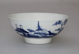 A late 18th century English porcelain tea bowl, decorated in underglaze blue in the oriental manner.