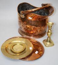 A Victorian copper helmet shape coal scuttle, a Victorian copper pan lid, a single brass ejector
