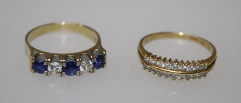 An 18k sapphire and diamond ring, channel set three blue sapphires alternated with two round
