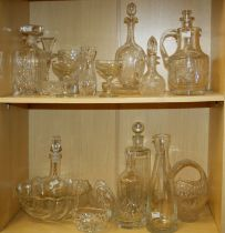 A mixed lot of cut and moulded glassware, including spirit and other decanters, water jug, two