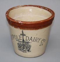 An Edwardian stoneware Maypole Dairy 4LB measure, with transfer decoration