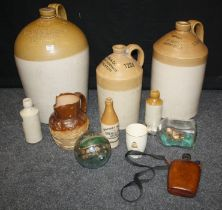 A large glazed earthenware storage jar, stamped John A Stephen, wine merchant, 27 High Street,