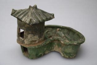 A large Chinese Han Dynasty terracotta farm group with silo and two feeding animals in kidney