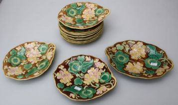 Eight 19th century continental majolica 22cm diameter plates, each florally decorated in shallow