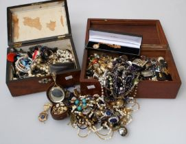 A large collection of costume and paste set dress jewellery including necklaces, brooches, earrings,