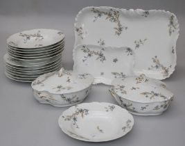 A Limoges porcelain part dinner service, retailed by James Green and Nephew, comprising a 47 x