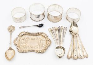 A collection of silver to include four napkin rings and teaspoons, various dates and makers, 8.86