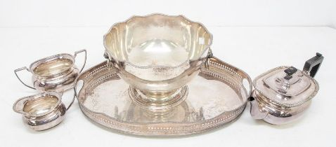 A Victorian style plated large punch bowl with lion's head and ring handles, weighted together