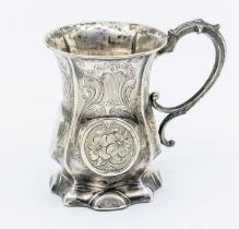 A Victorian silver baluster mug, engraved decoration and central roundels, with later presentation