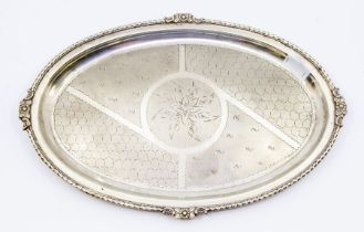 A silver Neo-classical oval tray, having a scrolled border with floral cast decoration to each side,