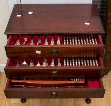 A canteen of Community plate, ornate design, in a mahogany stand, including three drawer unit with