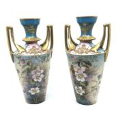 A pair of limoges vases 29cm high