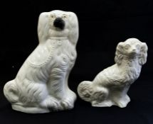 A large Staffordshire pottery hearth dog with gilt and coloured highlights, 35cm high and a