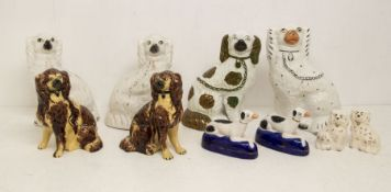 A pair of Staffordshire pottery dogs, another pair with treacle glaze, a Beswick pair, a pair of