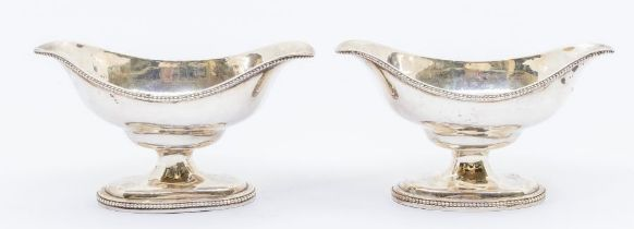 A pair of George III silver oval double lipped salts on raised feet, London, 1784, maker's mark