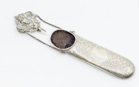 An Edwardian silver Chatelaine spectacle holder, the body engraved with leaves, the ornate clasp