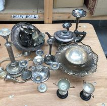 A collection of silver plated items, to include:- small trophies, candlesticks a three piece tea