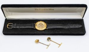 A Franklin Mint silver gilt gents watch, leather strapand two gold platedcollar studs