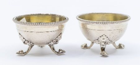 A pair of Victorian circular salts, beaded rims above engine turned squiqqle work lower sections, on