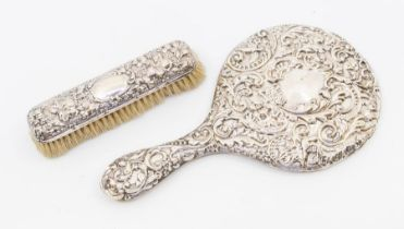 An Edwardian silver mounted dressing table mirror, profuse decoration, Birmingham, 1906 and a silver