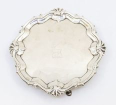 A George II cartouche shaped card tray / small salver, with raised stylised rocaille border, the