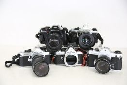 A collection of five 35mm vintage Pentax cameras with various lenses. Featuring: Pentax ME Super