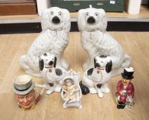 A group of Staffordshire to include: a pair of large Spaniels (extensive damage to one) together