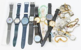 A collection of ladies and gents watches to include three gents vintage watches, Timex, Helvetia