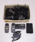 A collection of vintage tech including Nokia phones, micro recorders, cables etc