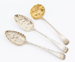 Two George III silver berry spoons, London, 1800 & 1804 together with a George IV sauce ladle,