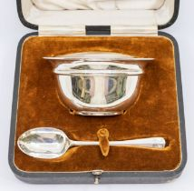A George V plain silver bowl and matching spoon (Christening Set), hallmarked by Walker & Hall,