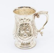 A Victorian silver baluster tankard, profuse chased floral decoration to body, C-scroll handle