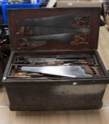 Tool trunk on castors containing all wooden handled tools including a plane, chisels, drill, set