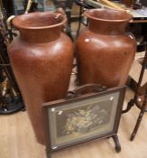 A pair of coated tall terracotta vases 20th Century, along with a mid 20th Century fire screen