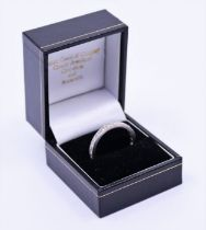 An 18ct white gold diamond eternity ring of a large ring size gross 5g