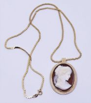 Gold cameo and a chain